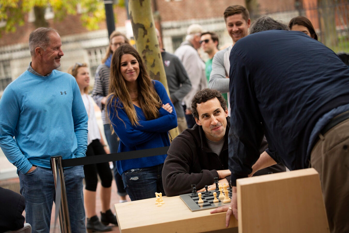 Two people playing chess outside the Smith Center