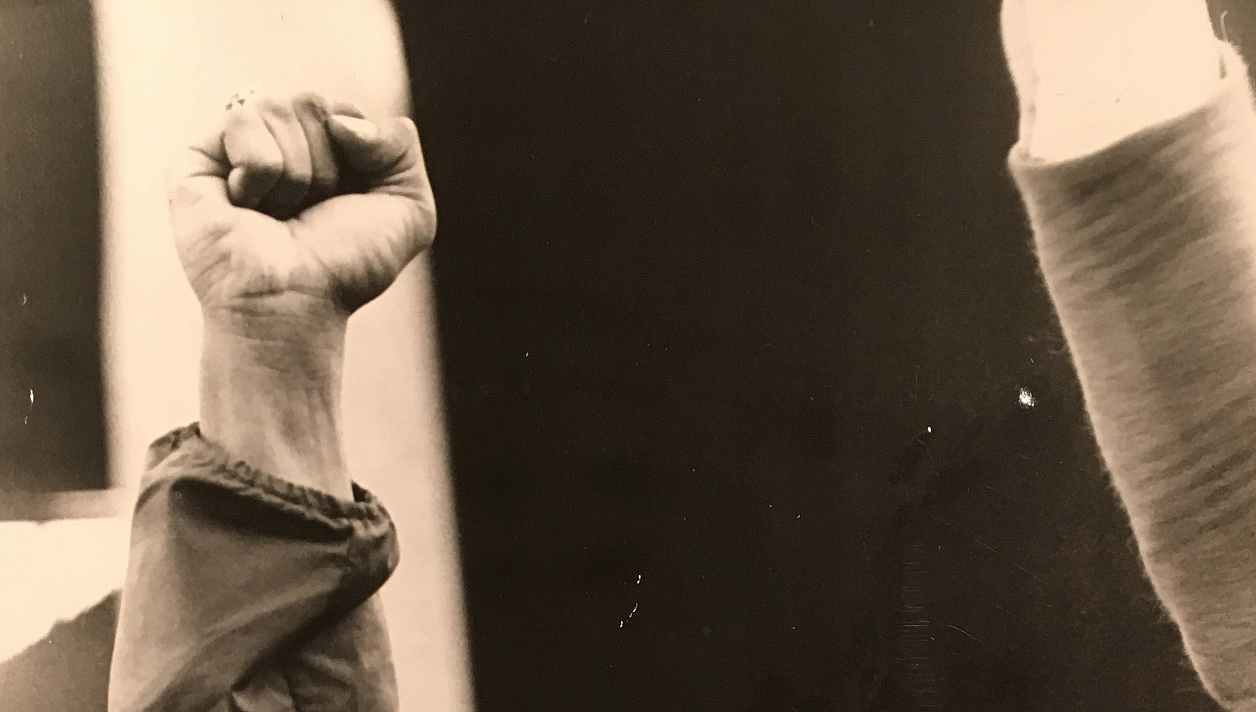 Closeup of a fist raised during 1969 strike.