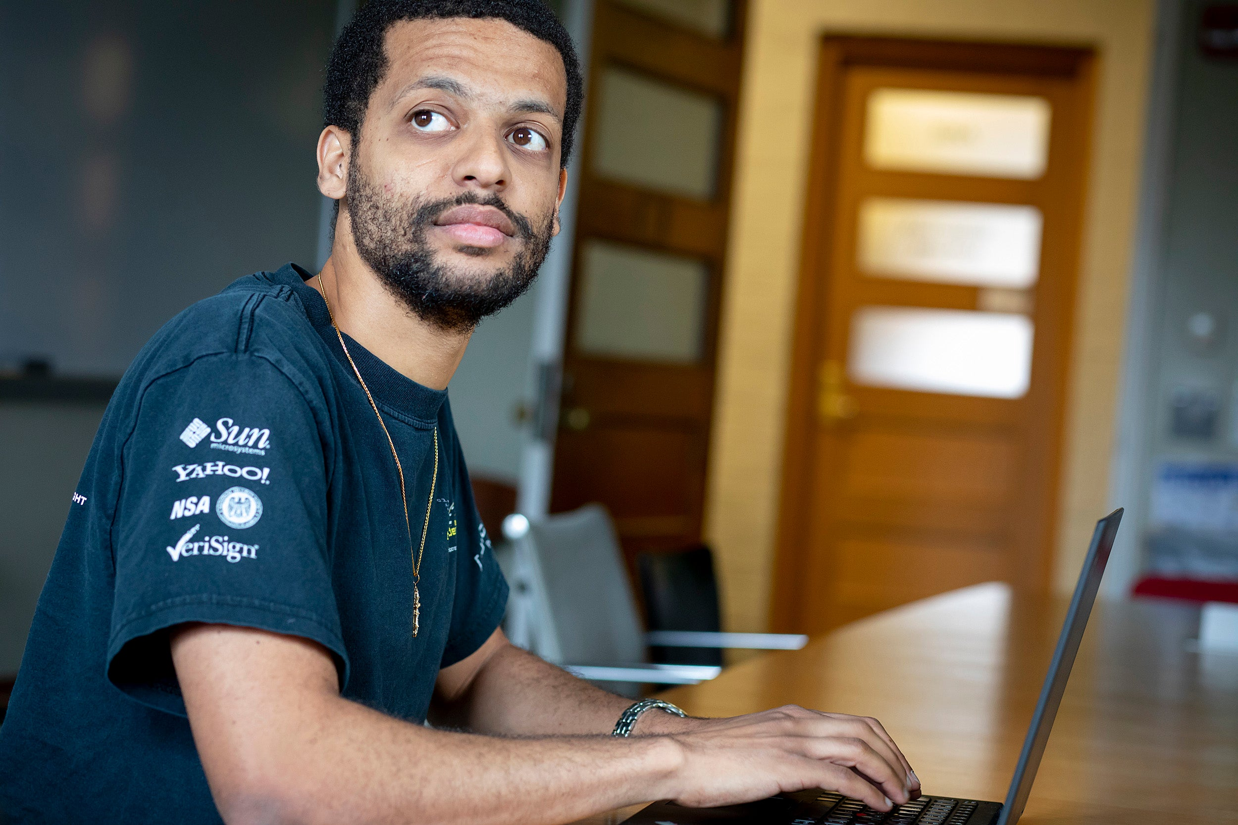 Jelani Nelson sitting in front of a laptop