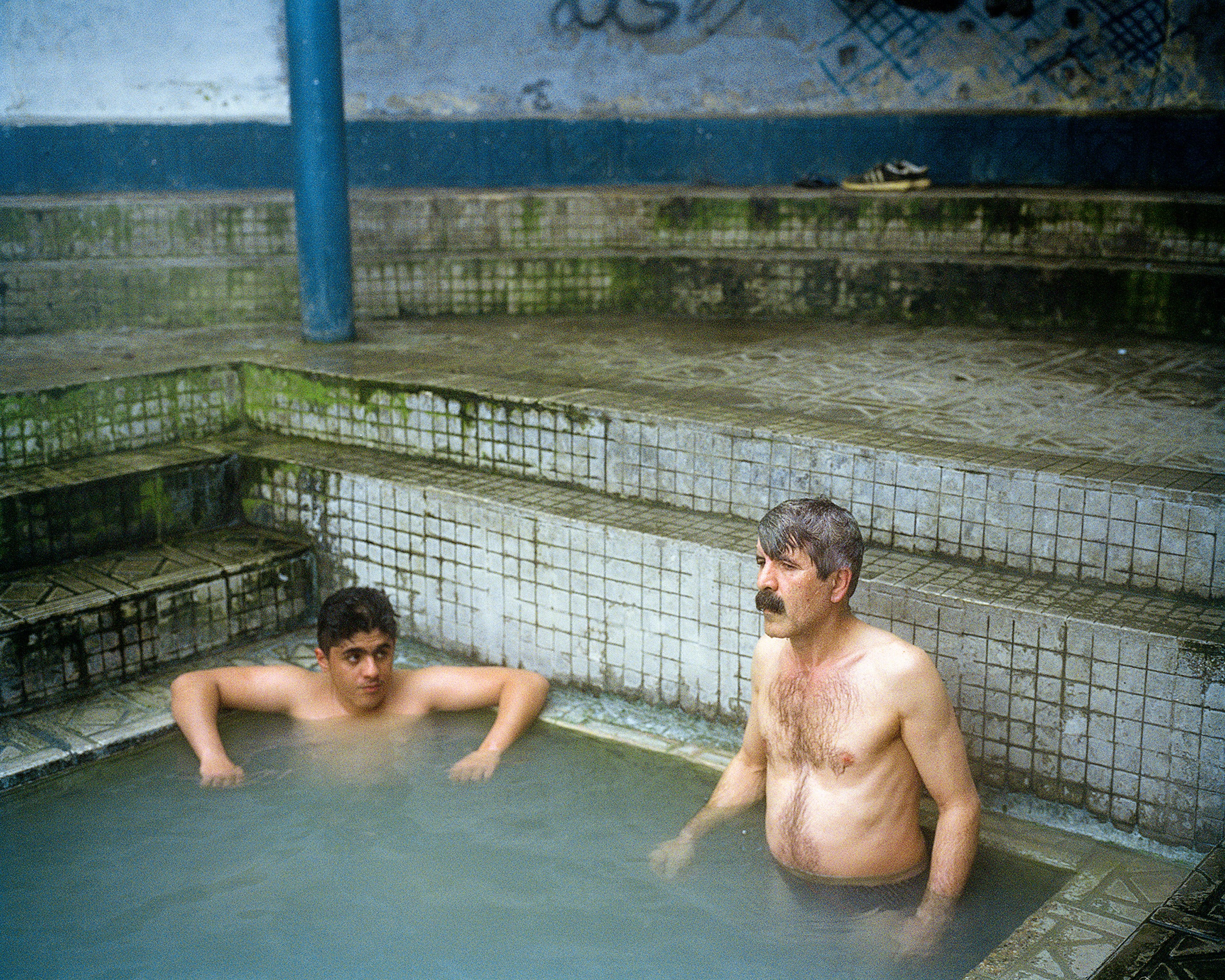 Father and son in Ishker hot springs.
