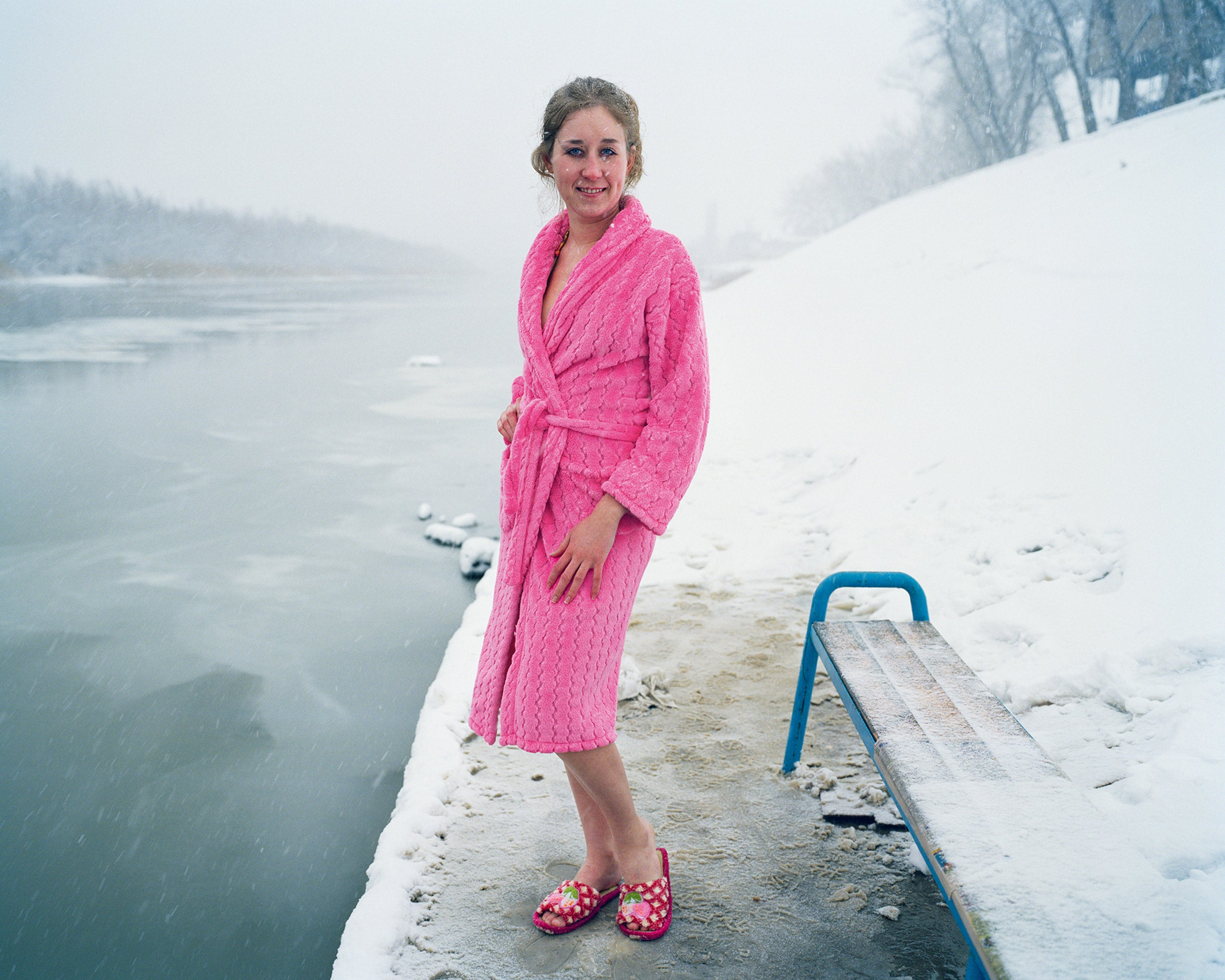 A young woman poses before entering the icy water in Astrakhan, Russia.