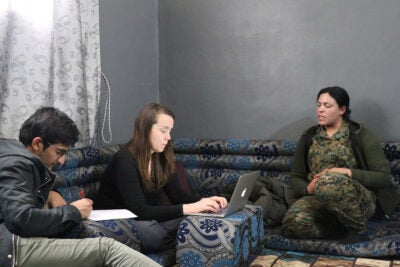 In northern Syria, Amy Austin Holmes conducts interviews