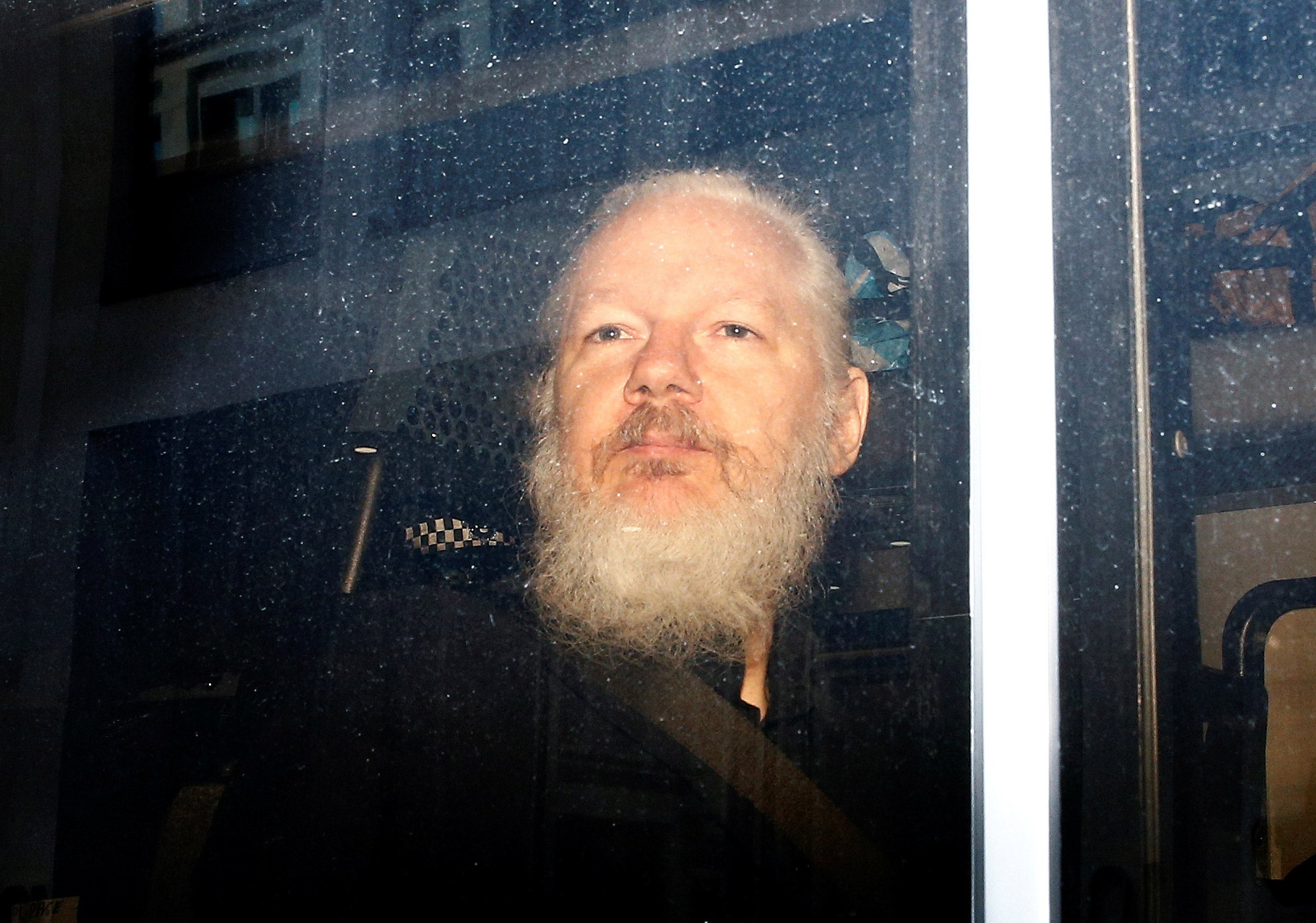 Julian Assange in a police van.