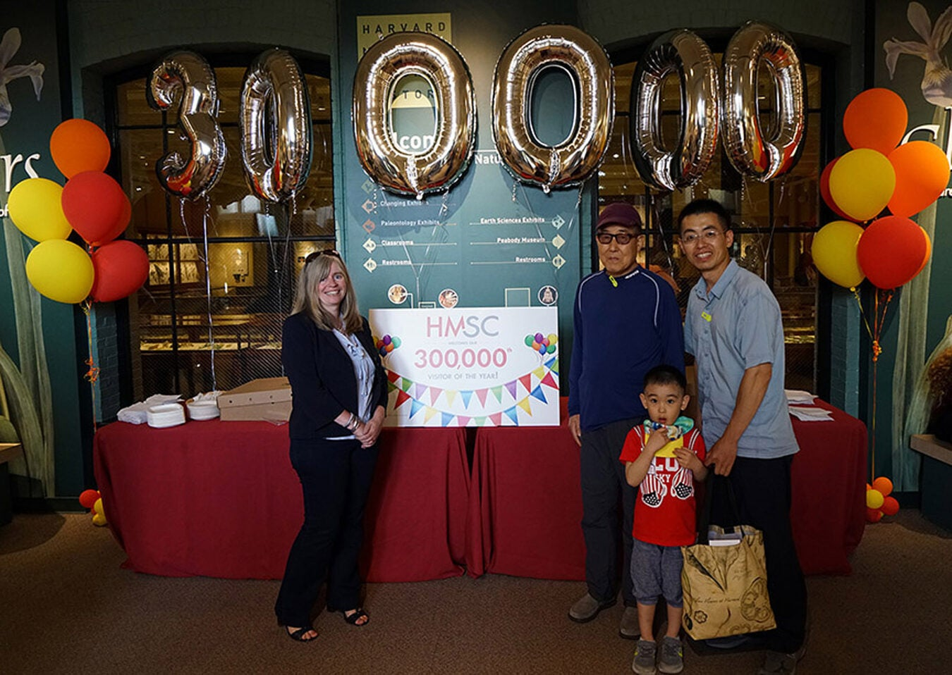 The 300,000 visitors to the museum standing with balloons