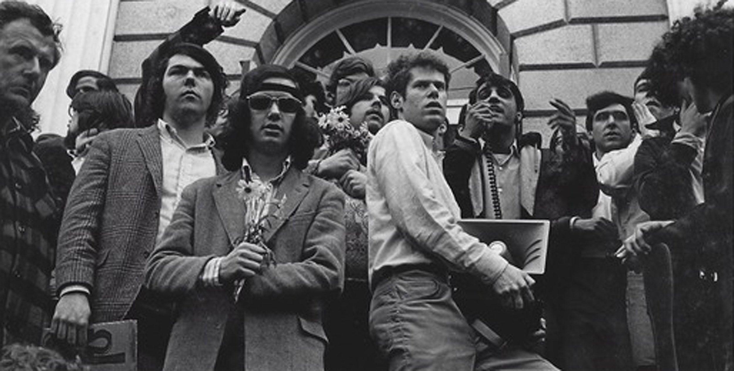 Nate Goldshlag in 1969 holding bullhorn amid protesters.