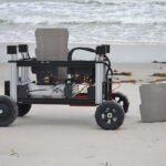 Romu the robot in the sand