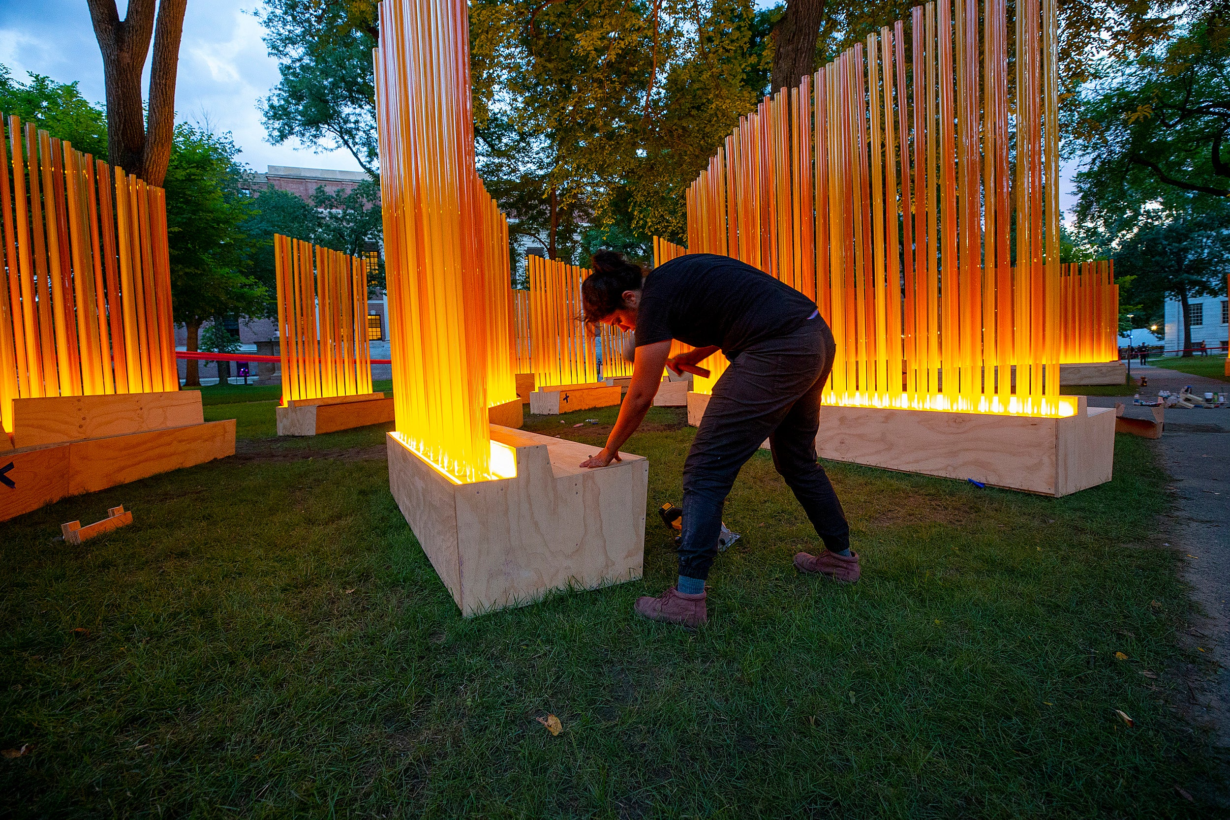 A woman putting the art installation together