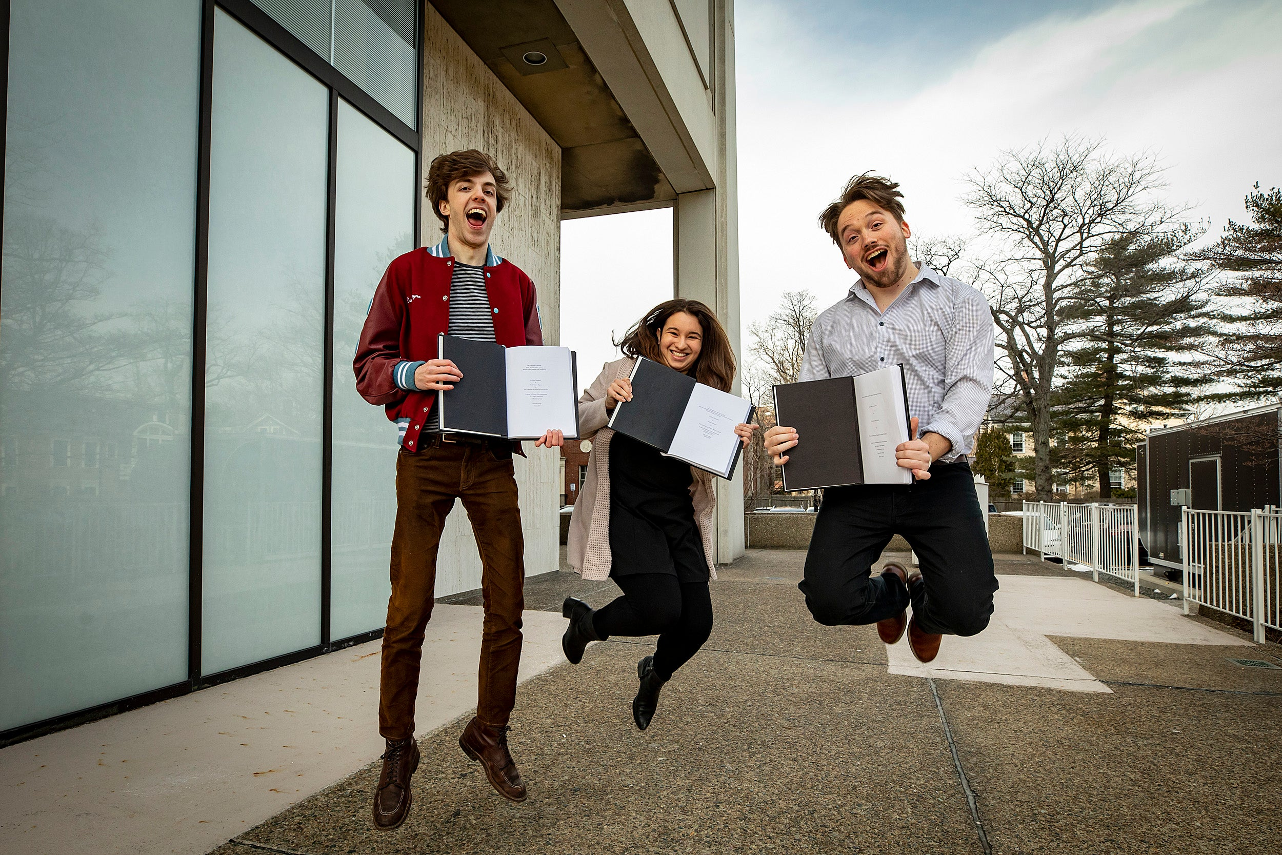 "David Shayne, from left, Juliana Rodriguez, and Trevor Levin, senior concentrators in Social Studies handed in their thesis on ""Thesis Day."""