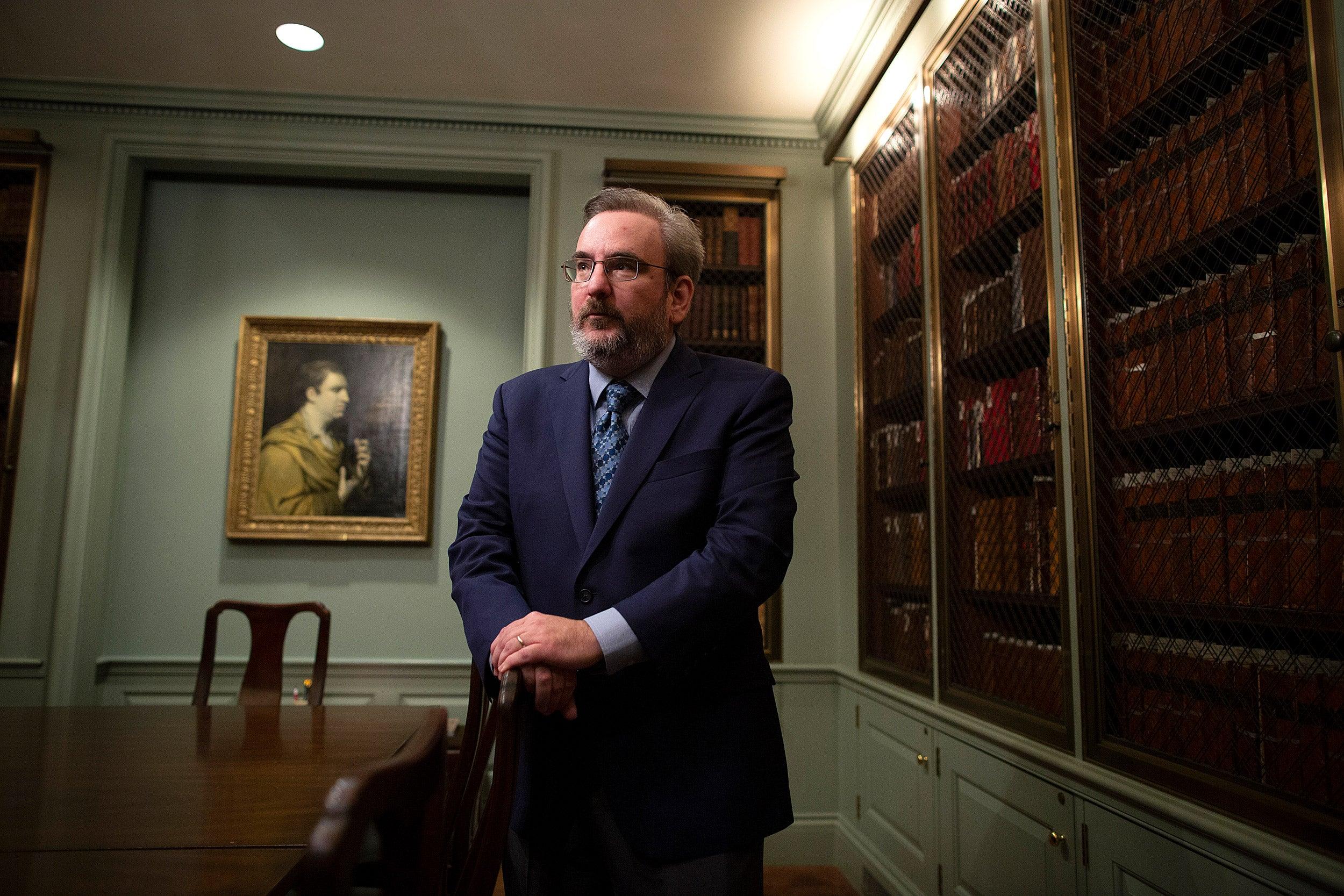 John Overholt in Houghton Library's Edison & Newman Room.