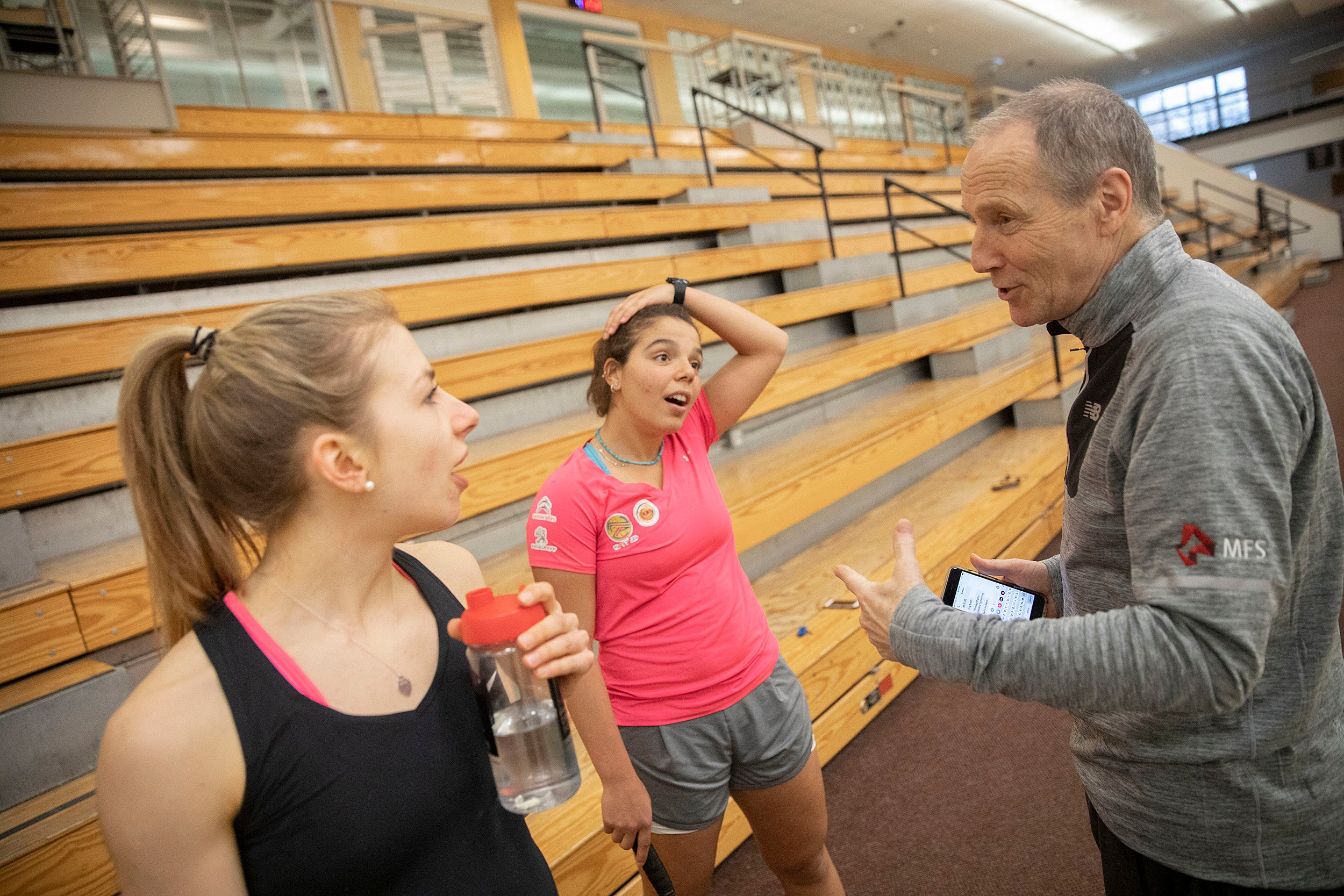 Amelia Henley and Amina Yousrytalk to coach Mike Way at the Murr Center.