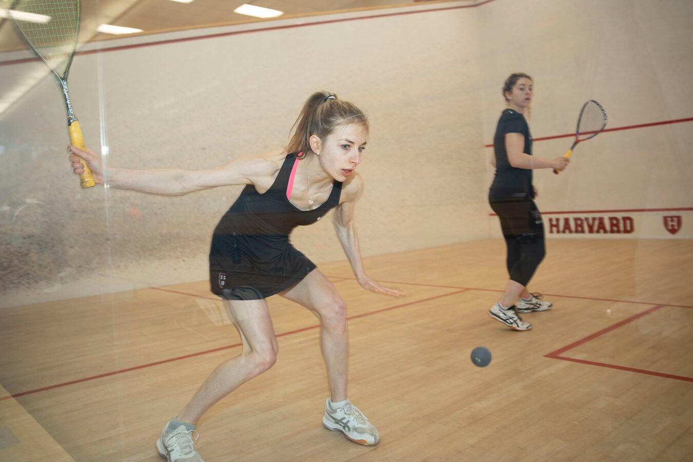 Amelia Henley holds a squash racket.
