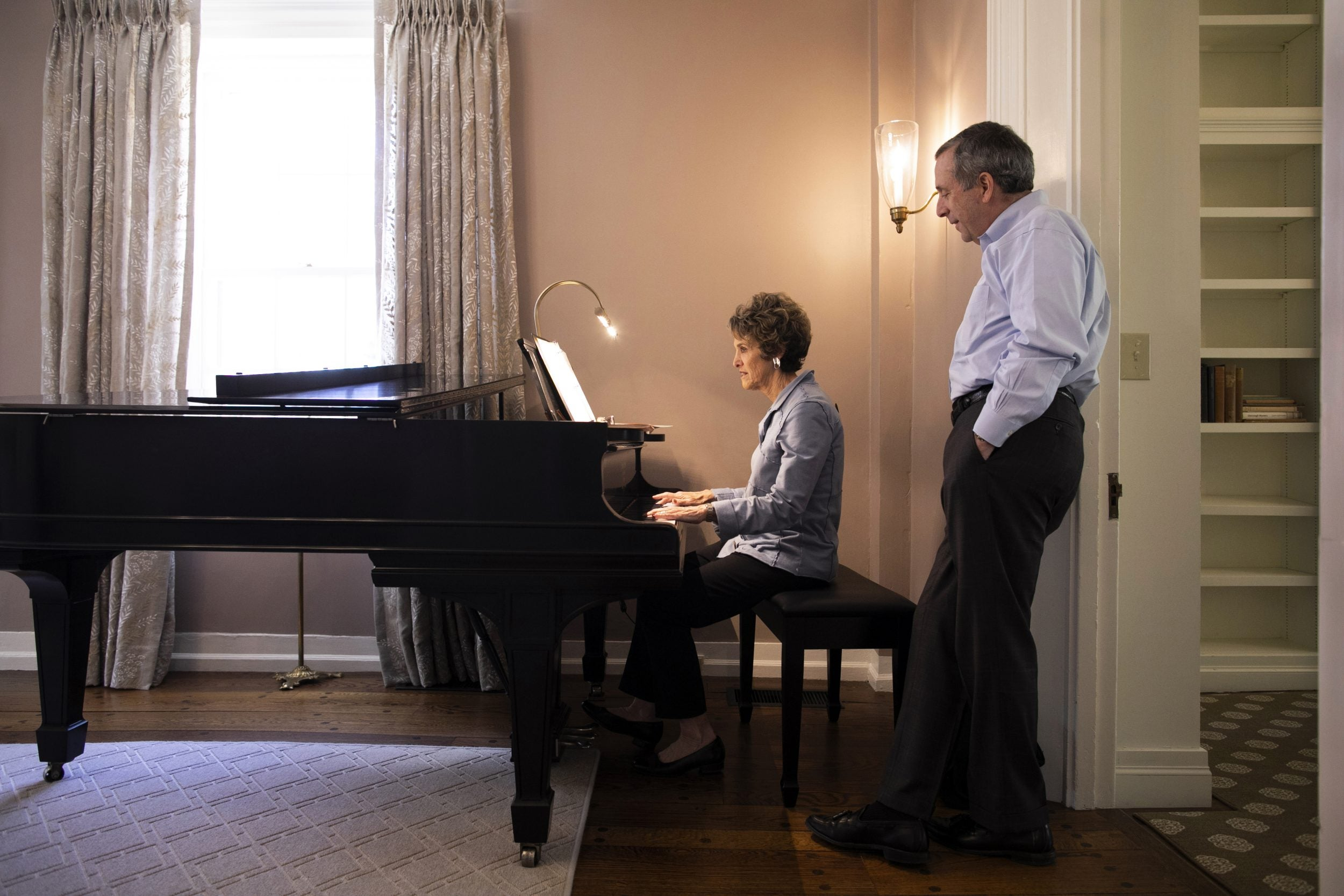 Adele Fleet Bacow playing the piano for husband, Larry Bacow.