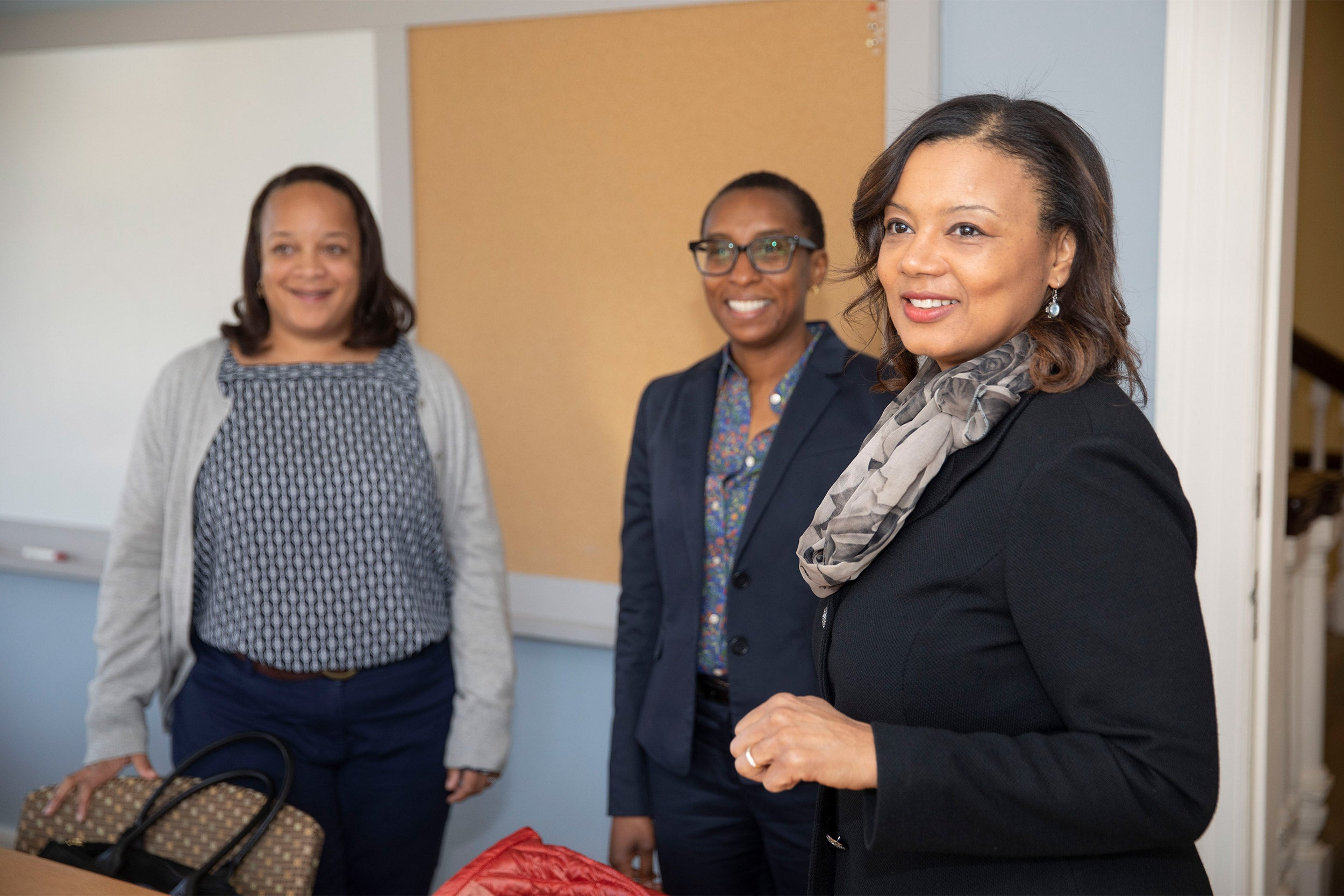 Bridget Terry Long, (from left) Saris Professor of Education and Economics, Dean of the Harvard Graduate School of Education (HGSE), Claudine Gay, the Edgerley Family Dean of the Faculty of Arts and Sciences (FAS), Tomiko Brown-Nagin, dean of Harvardís Radcliffe Institute for Advanced Study, meet in Fay House.