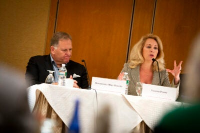 two people speaking on a panel