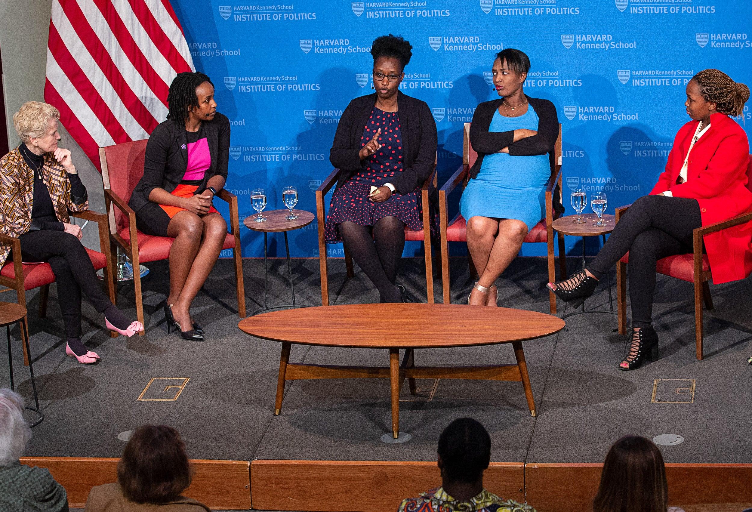 five women speaking on a panel