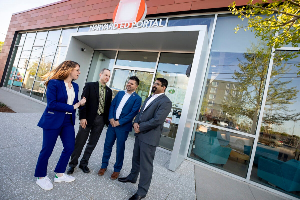 four people talking outside the Harvard Ed Portal building