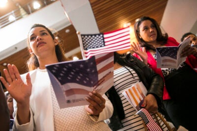 two women pledging during a citizenship ceremony