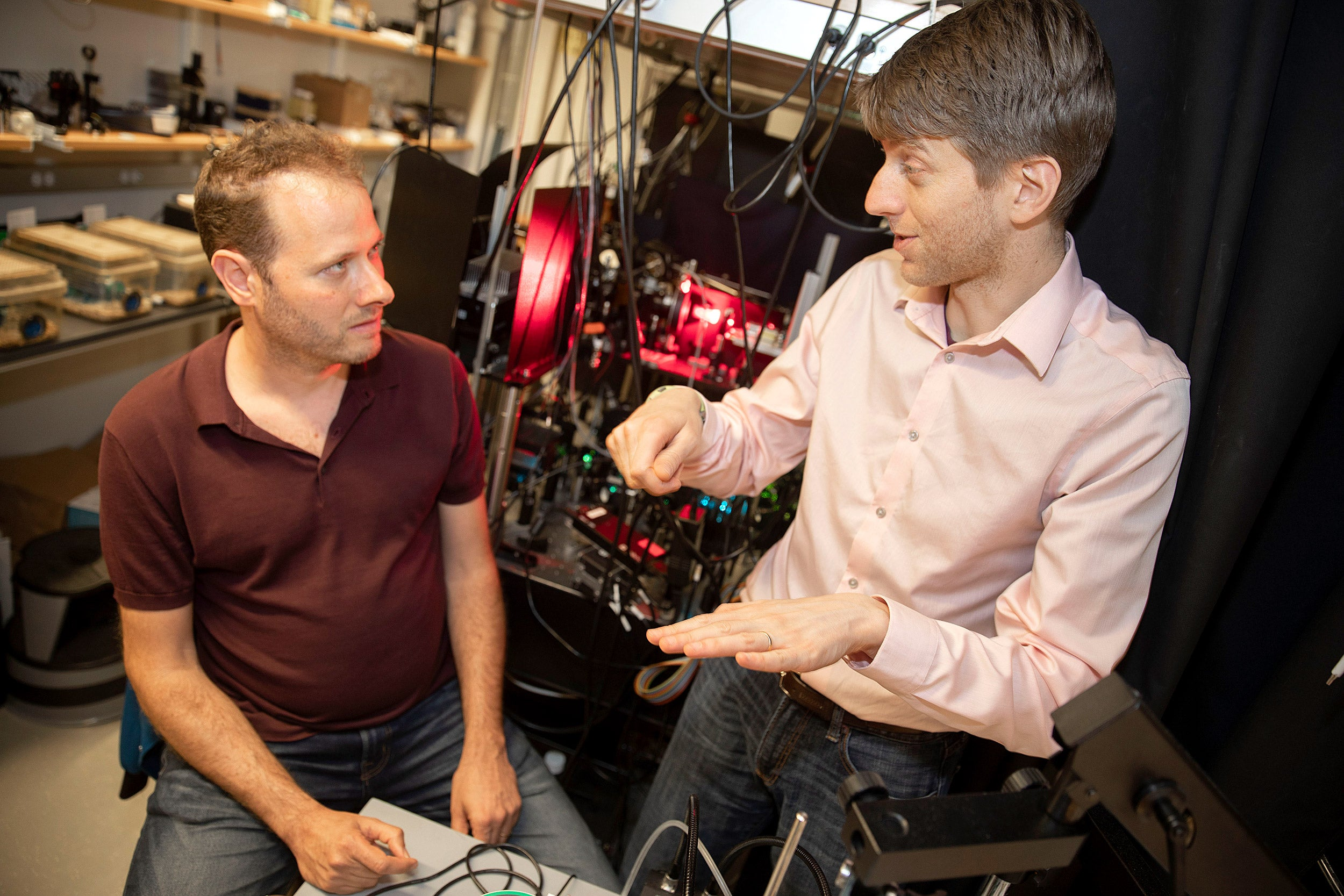 Adam Cohen and Yoav Adam discuss their findings in Mallinckrodt Lab.