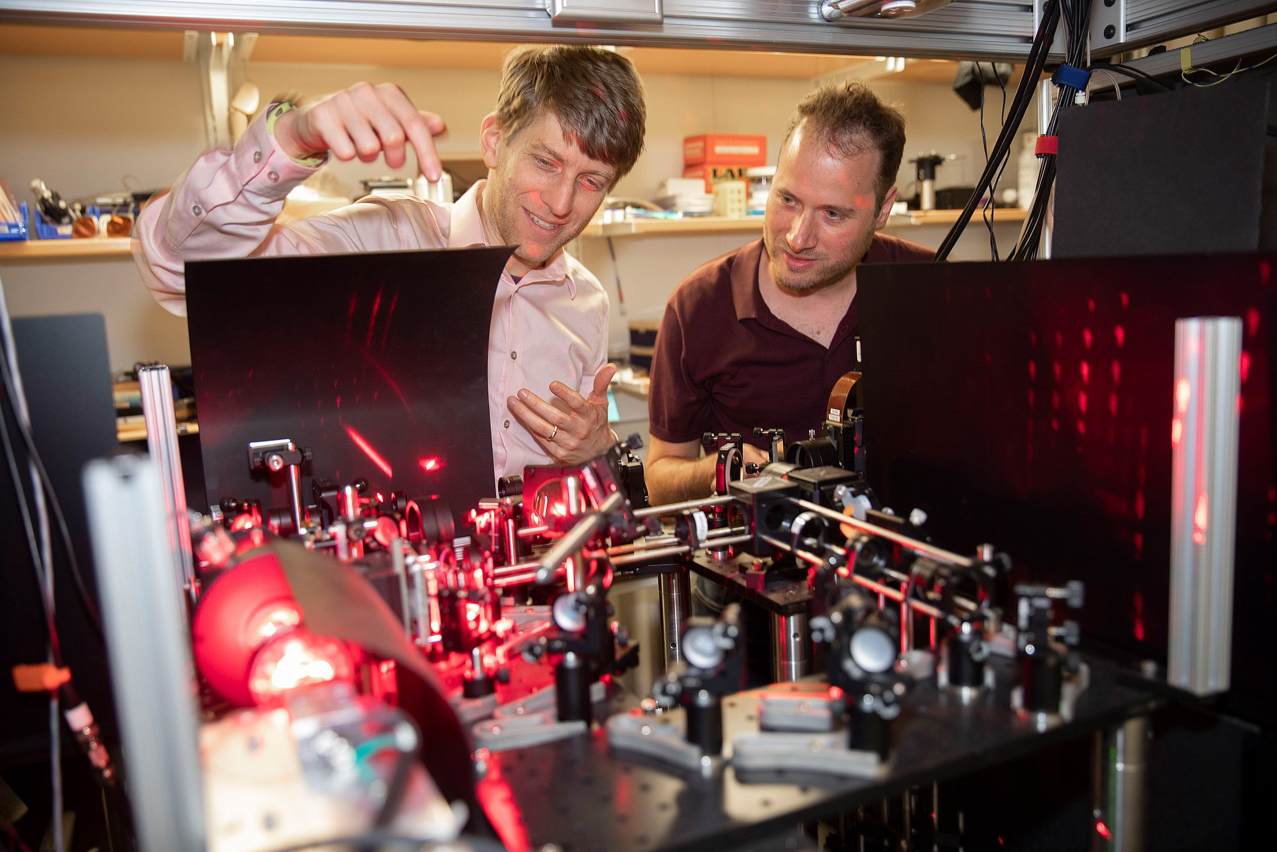 Researchers Adam Cohen and Yoav Adam examine their experiment in the lab
