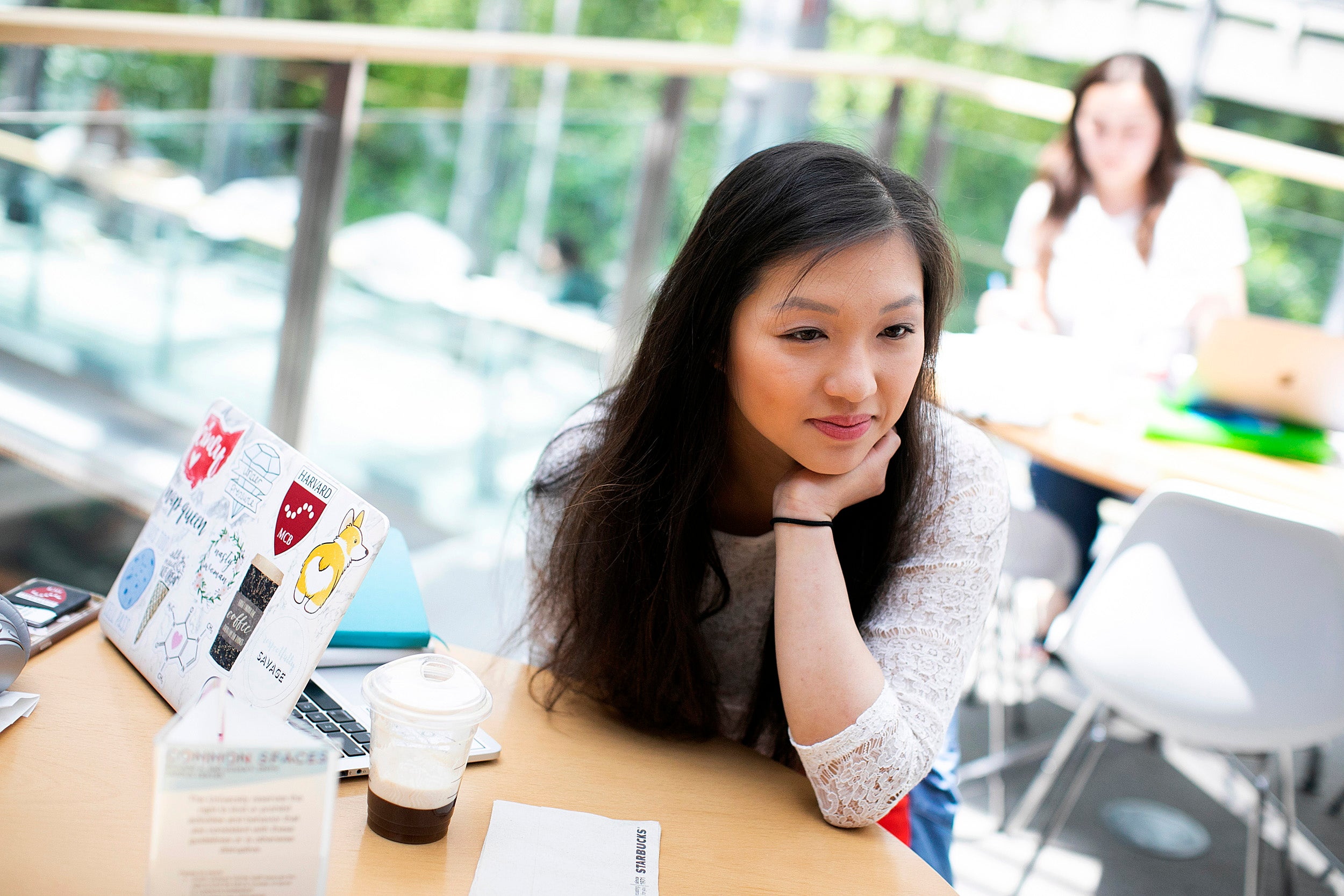 Allison Yan looks pensive next to her sticker-covered laptop