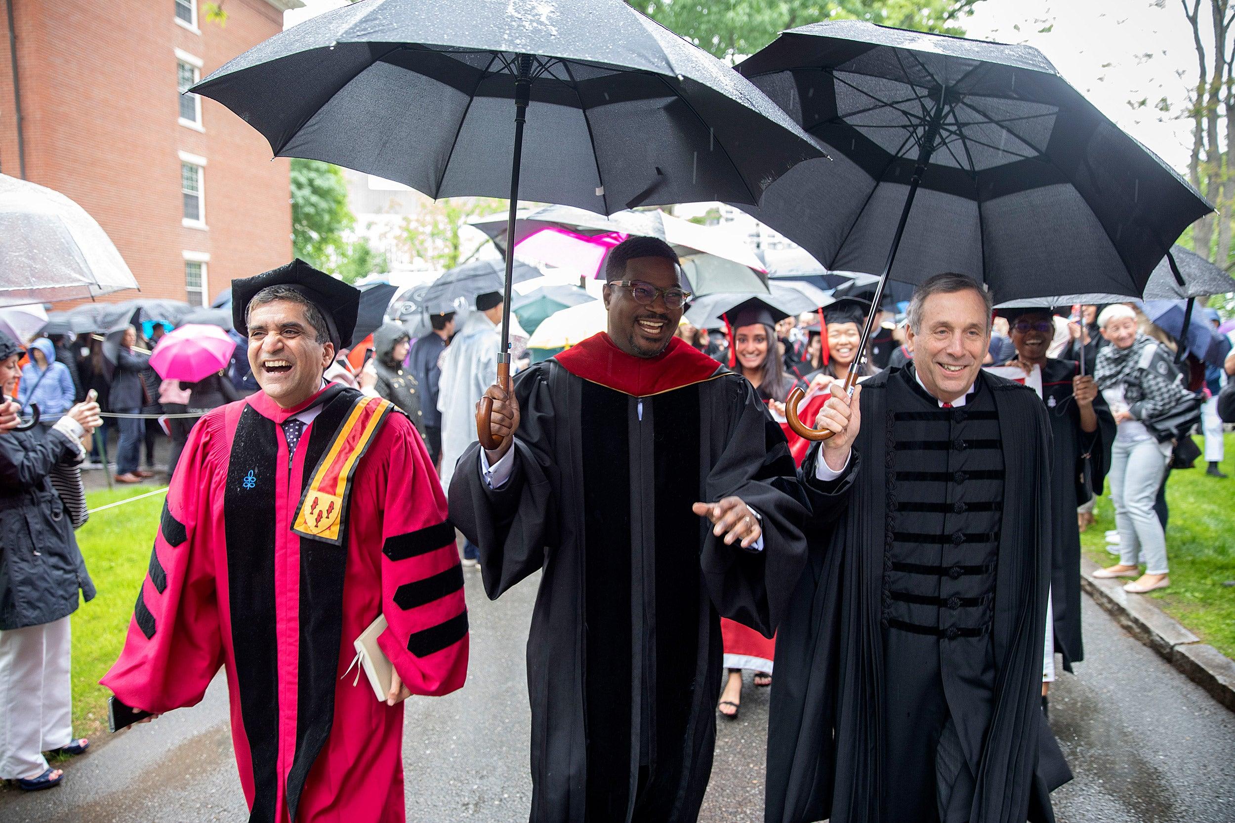 Rakesh Khurana, Jonathan Walton, and Larry Bacow lead the procession.