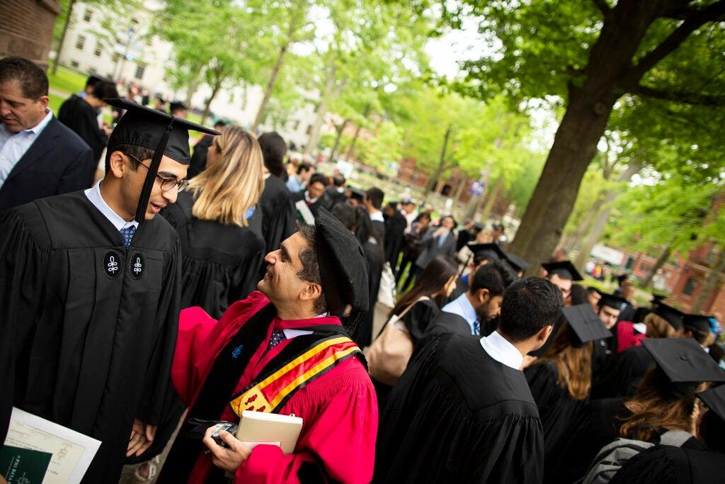 Kabir Gandhi and Harvard College Dean Rakesh Khurana speak in Harvard Yard.