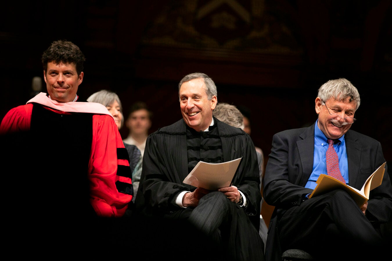 Director of Choral Activities and Senior Lecturer on Music Andrew Clark (from left), University President Larry Bacow, and Eric Lander sitting together.