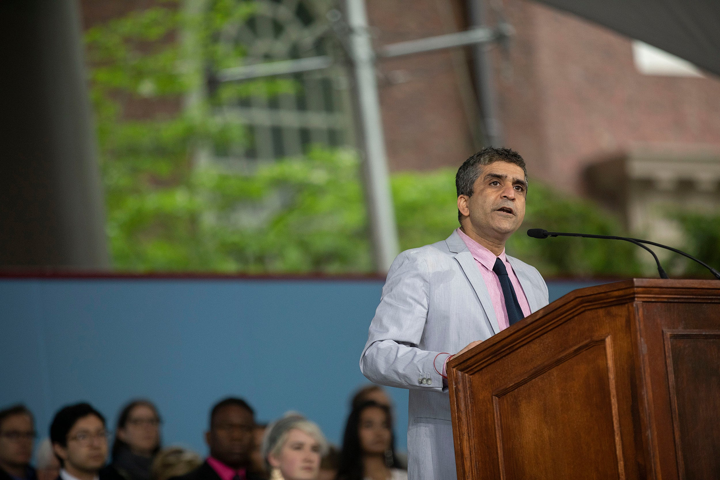 Dean of Harvard College Rakesh Khurana speaks at the podium