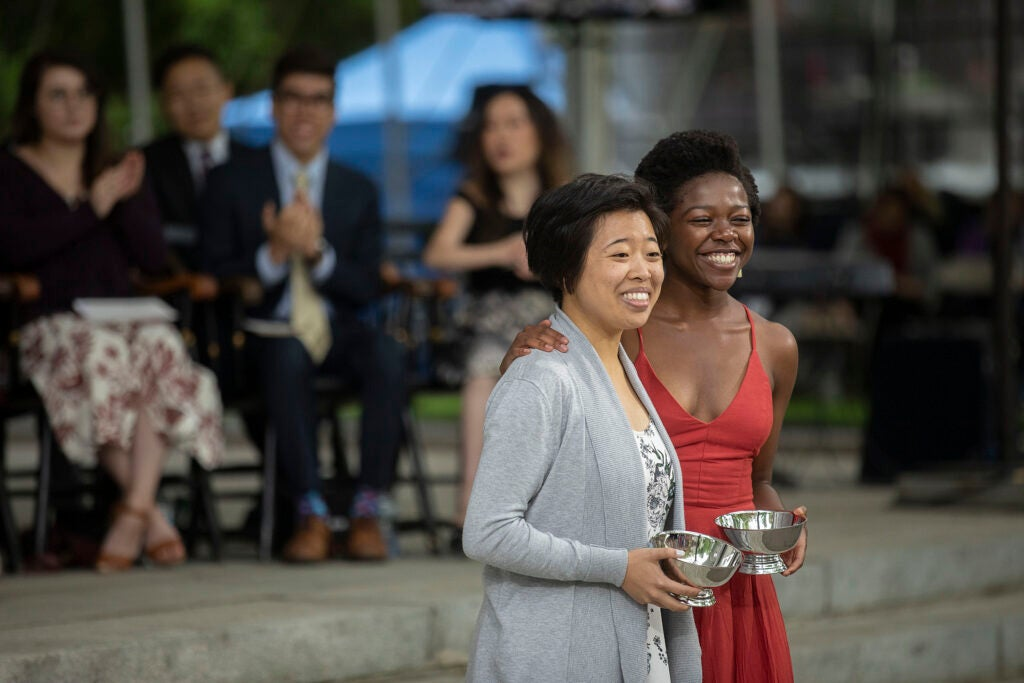 Sally Chen (left) and Jessica Ekeya pose with their awards