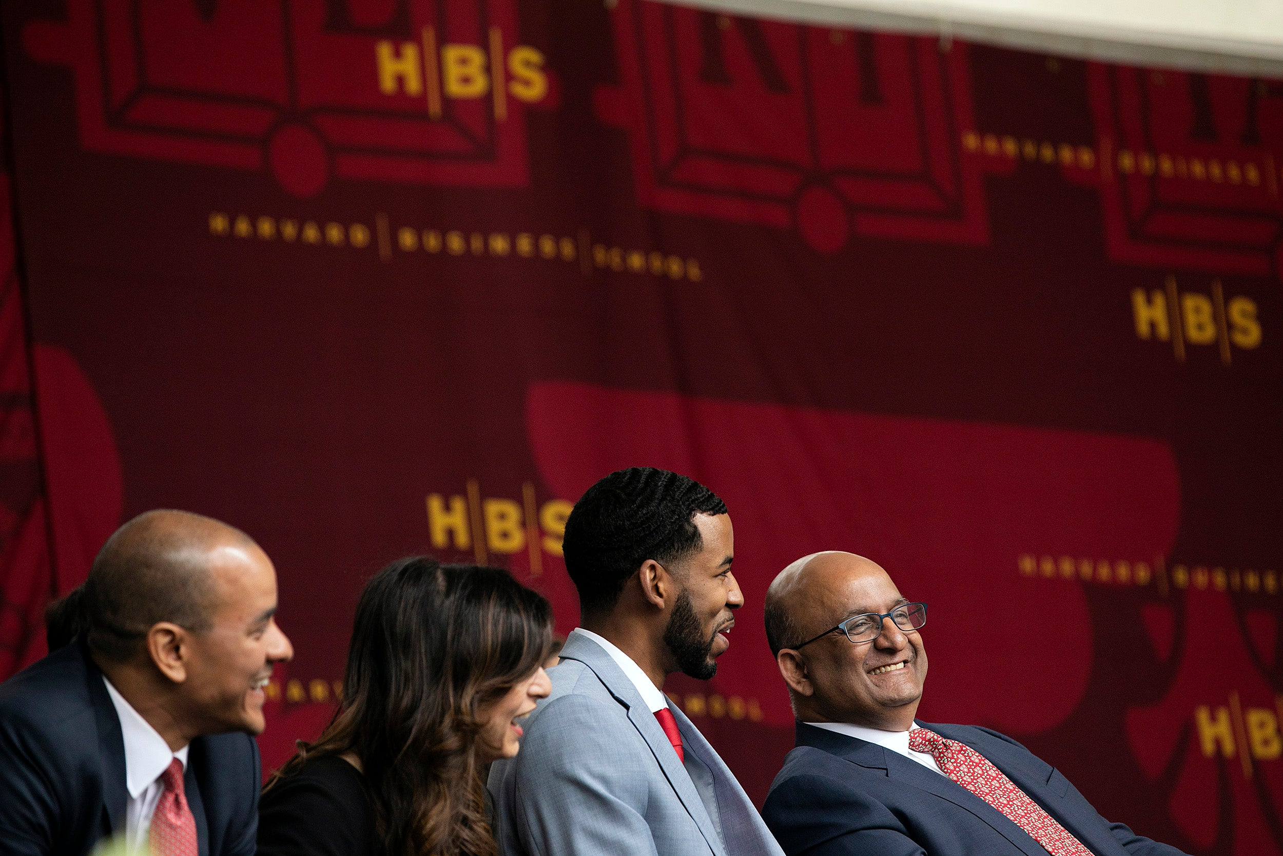 M.B.A. Class of 2019 Student Association Co-Presidents Triston Jay Francis (from left) and Sana Mohammed, join Class Day student speaker Brandon Rapp, and HBS Dean Nitin Nohria onstage during HBS Class Day. Stephanie Mitchell/Harvard Staff Photographer