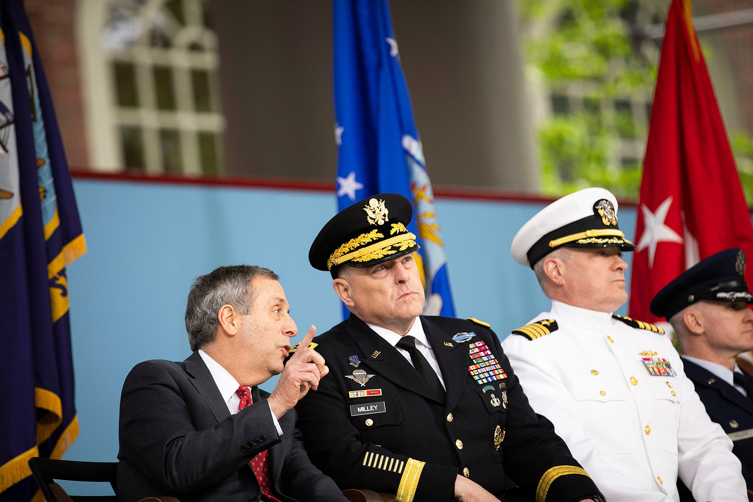 Harvard President Larry Bacow (left) speaks with General Mark A. Milley during there event.