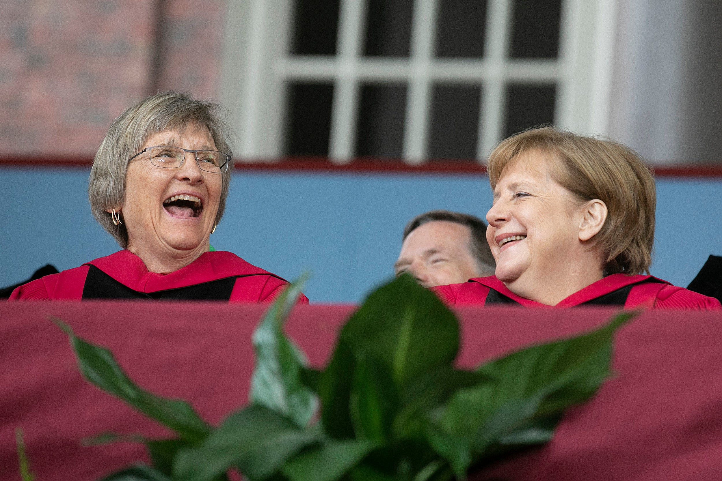 Drew Faust laughs with Angela Merkel