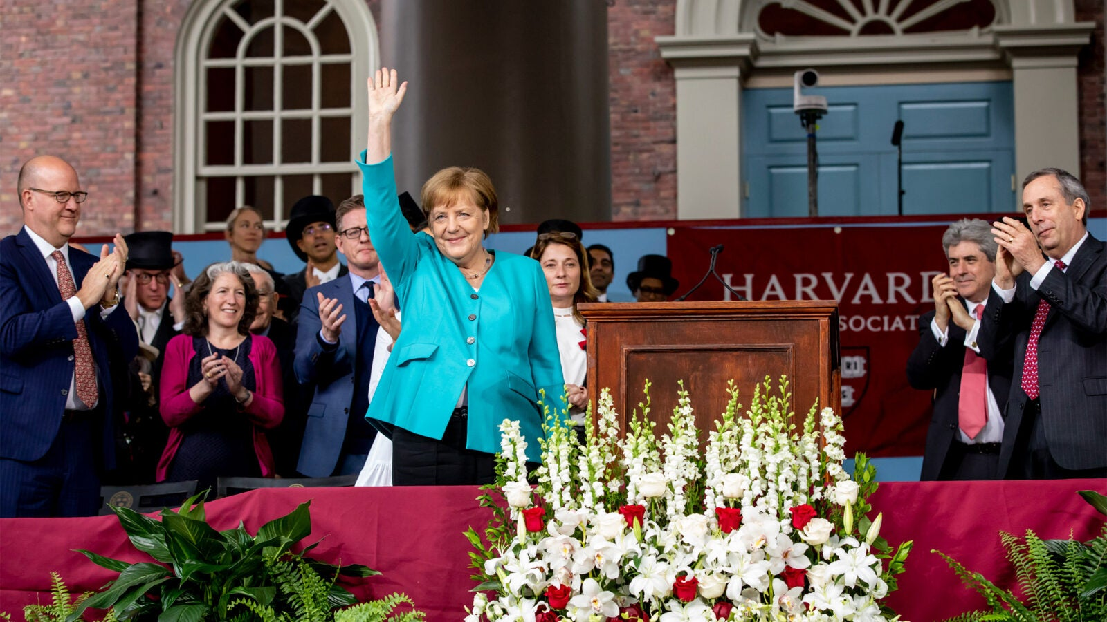 German Chancellor Angela Merkel waving to the crowd.