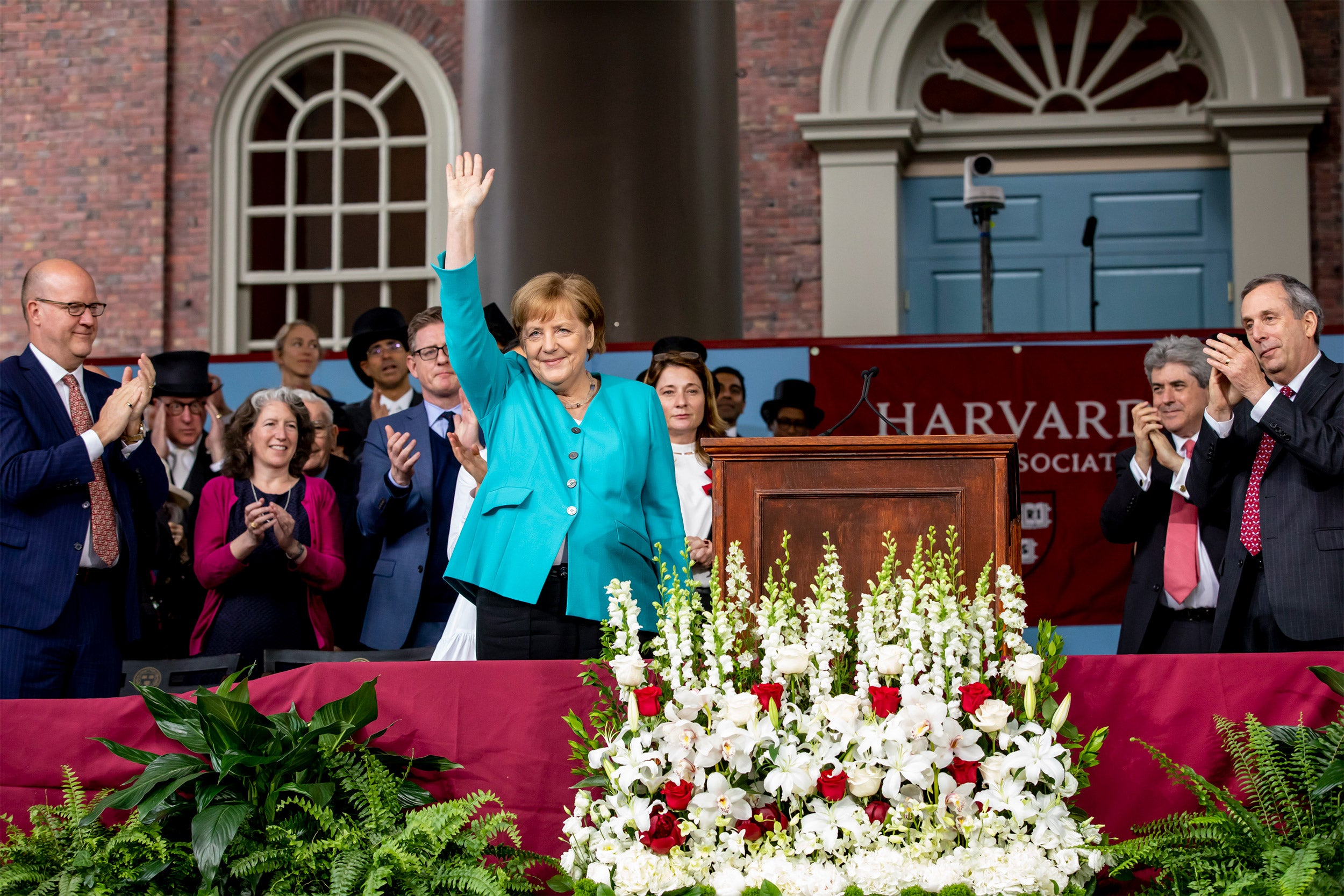 German Chancellor Angela Merkel waving to the crowd.