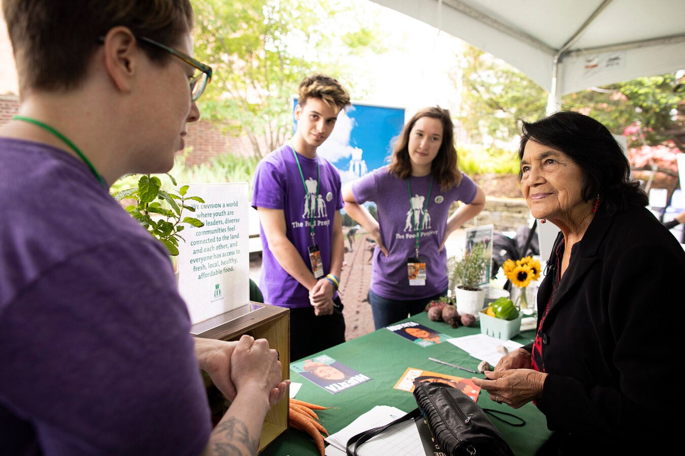 Dolores Huerta chats with members of The Food Project