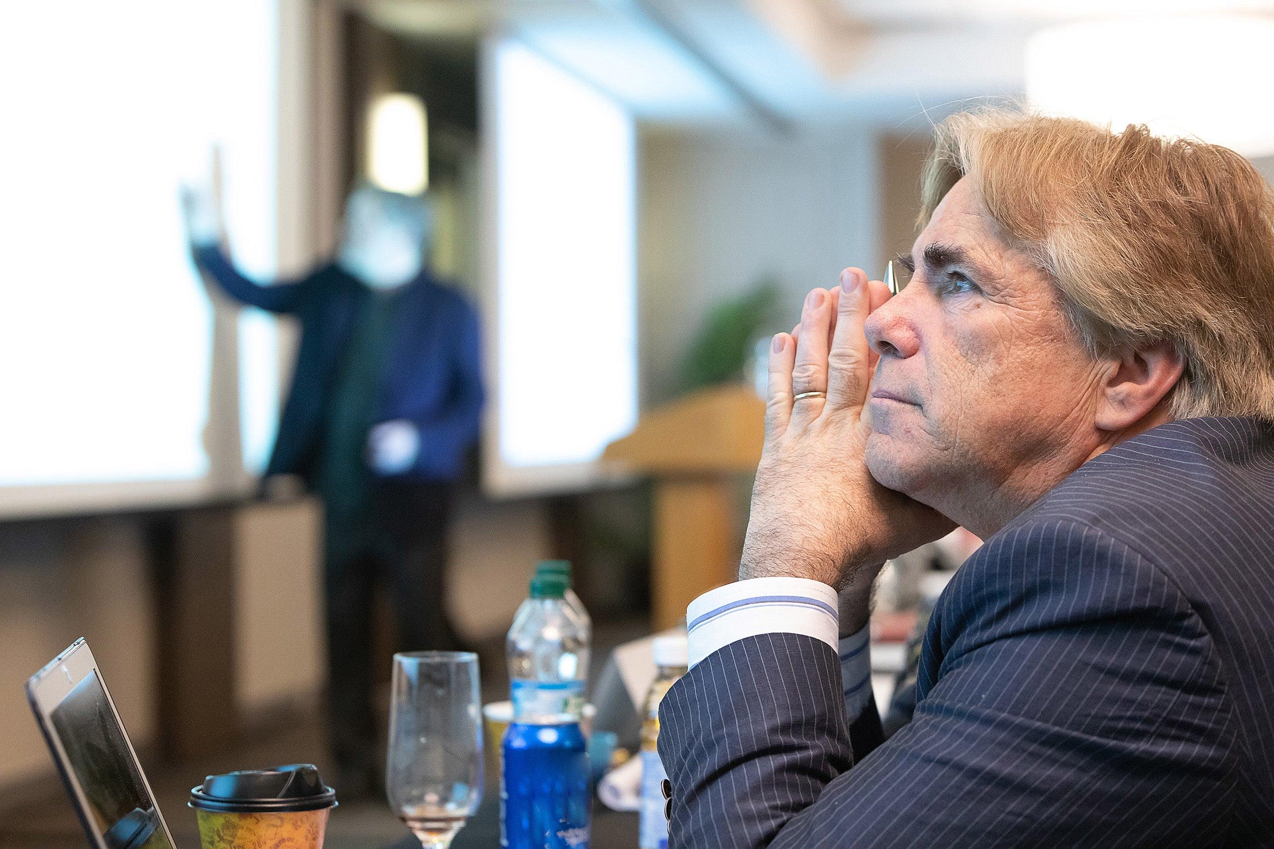 a participant listens to a presentation
