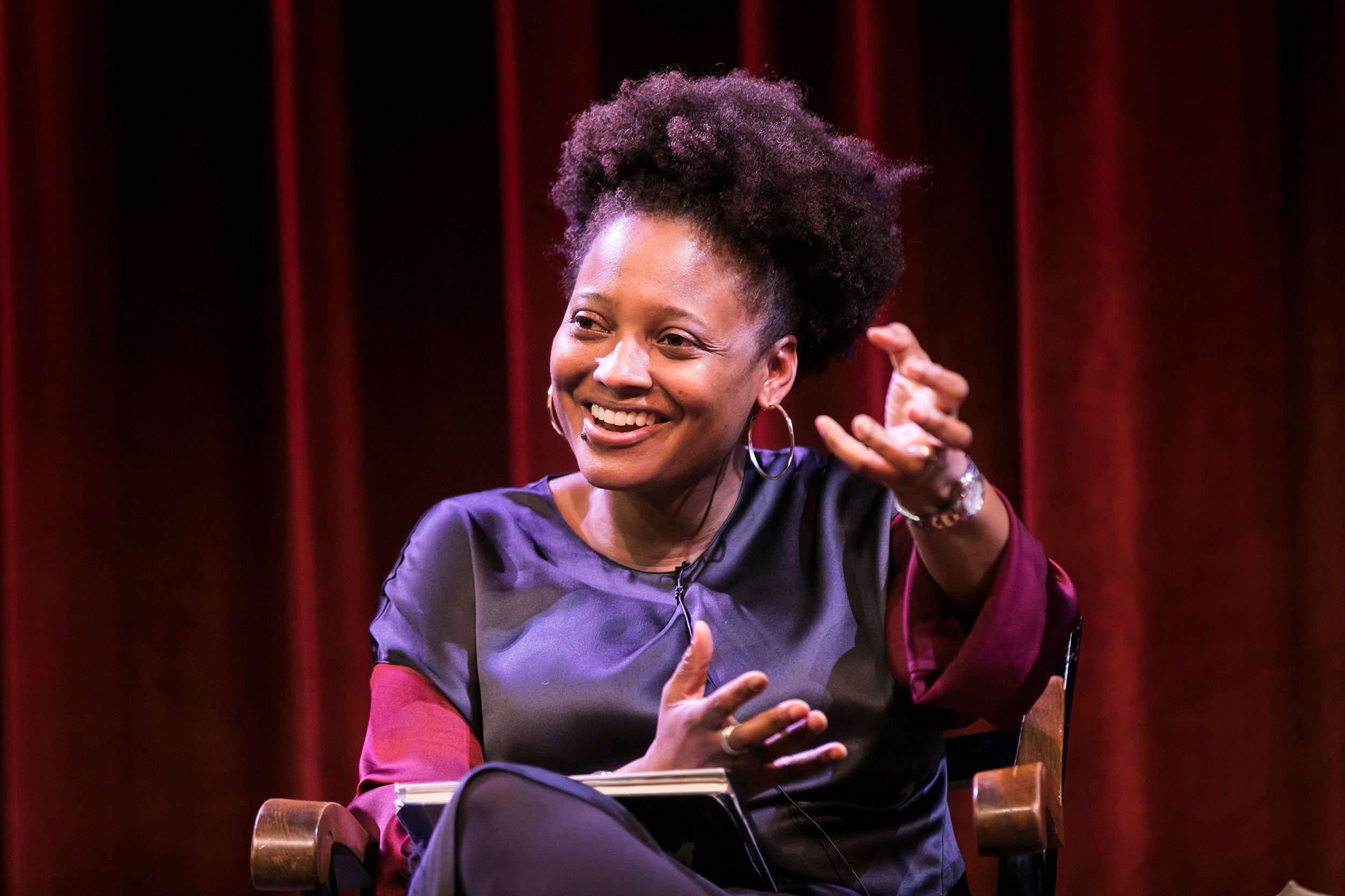 Tracy K. Smith seated on stage.