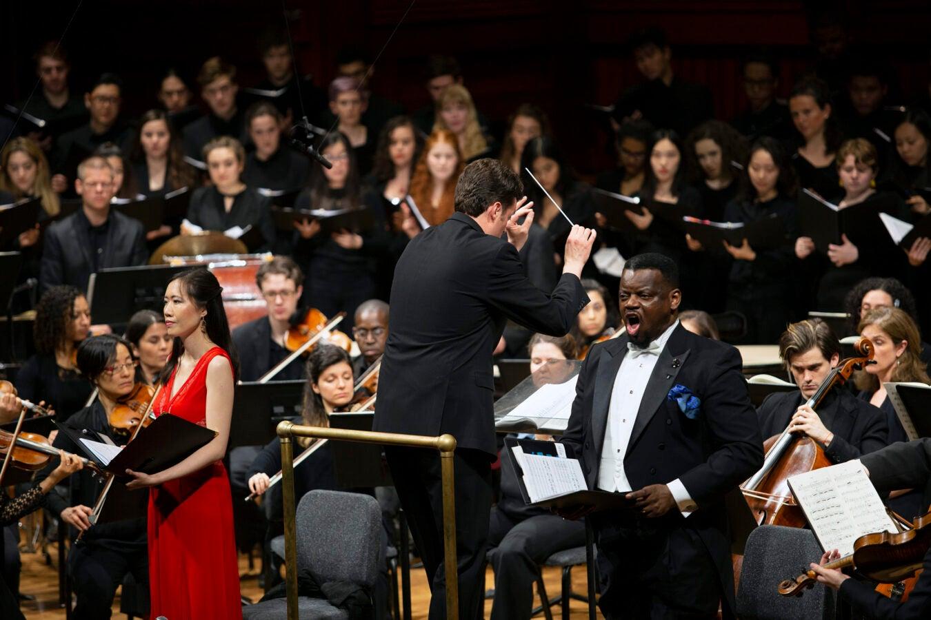Harvard Glee Club, Radcliffe Choral Society, and Harvard-Radclife Collegium perform.