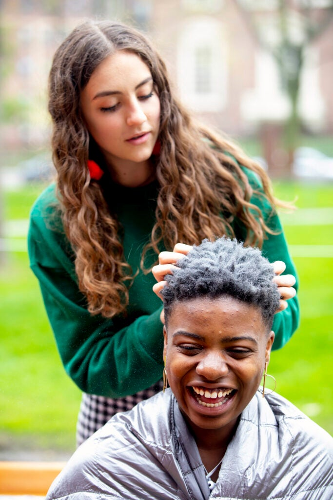 Lily Grob dyes Ruva Chigwedere's hair.