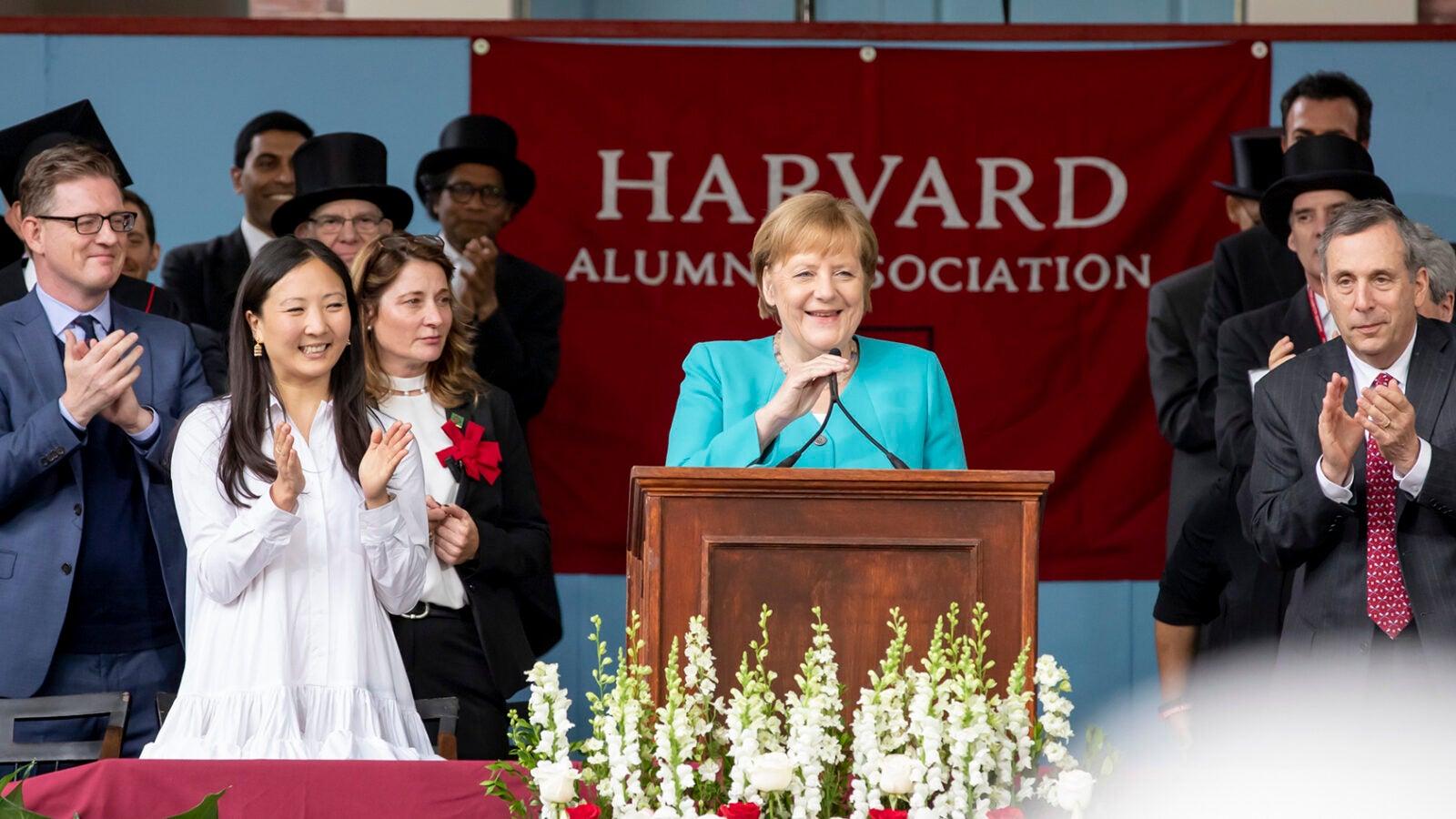 Angela Merkel speaks from podium.