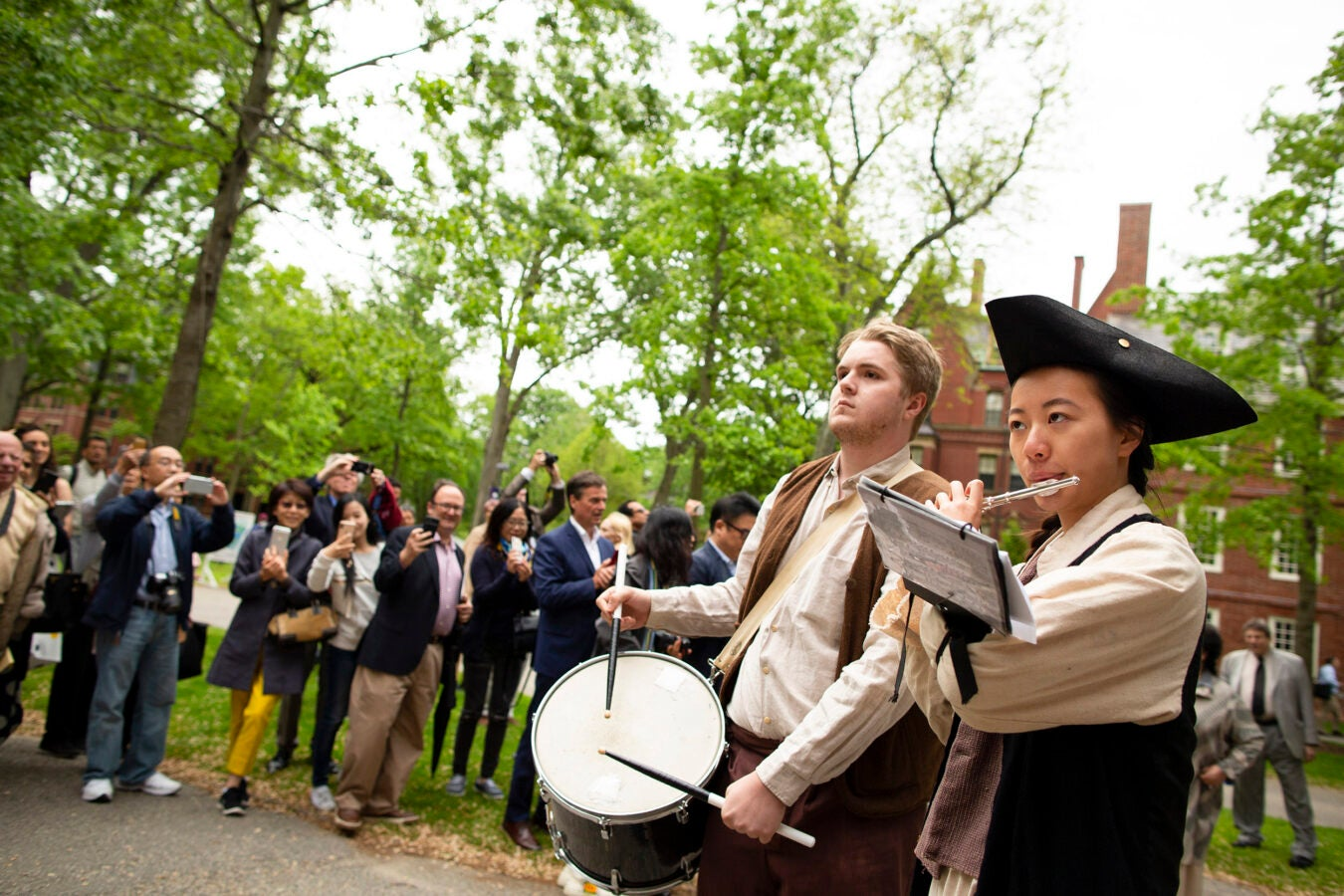 Ian Saum and Allison Law play drum and piccolo during procession.