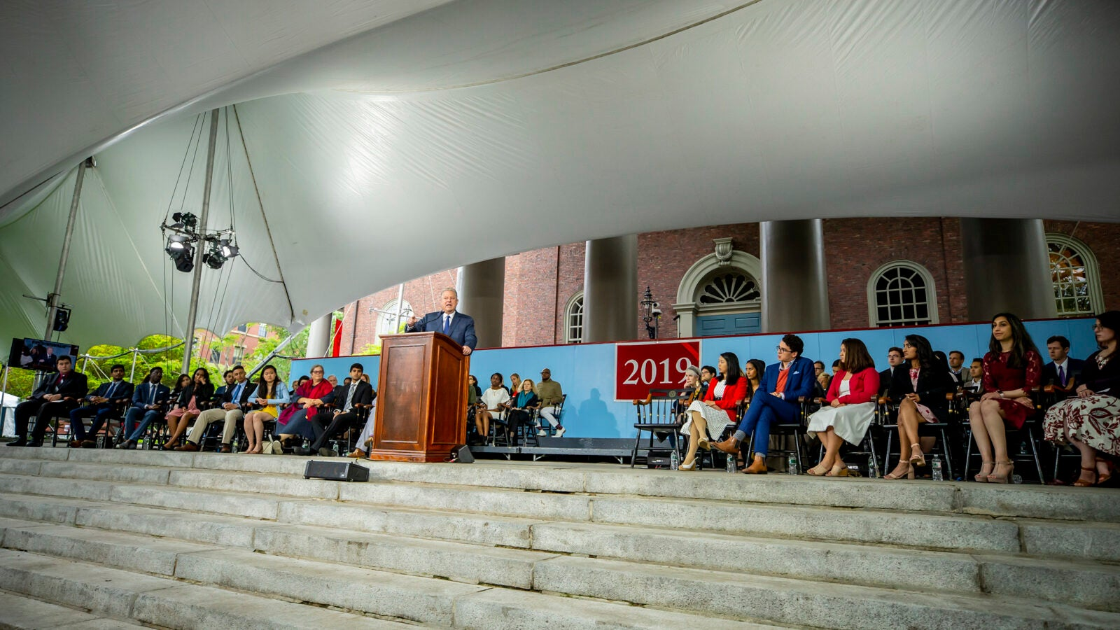 Al Gore speaks from podium during Class Day.