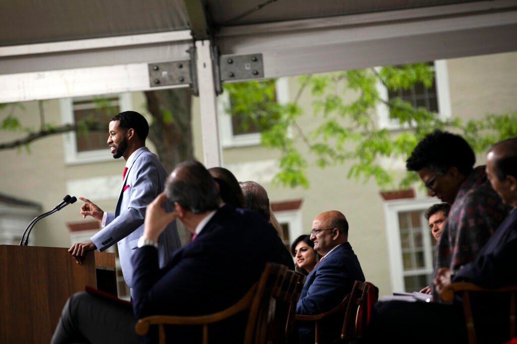 Brandon Rapp speaks from the podium during Class Day at Harvard Business School.