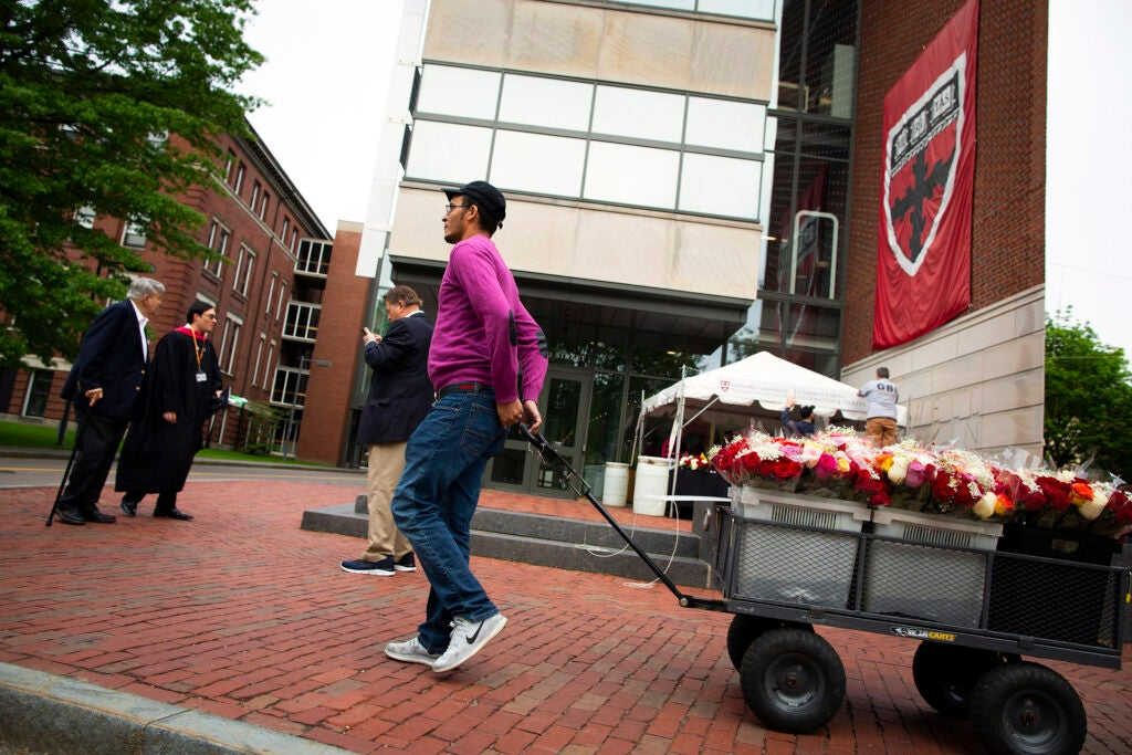 Azeddine Chetoui pulls cart of flowers to sell on Commencement morning.