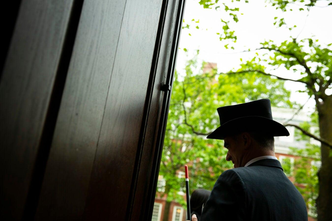 Jonathan Sapers wears a fancy hat outside Harvard Hall.
