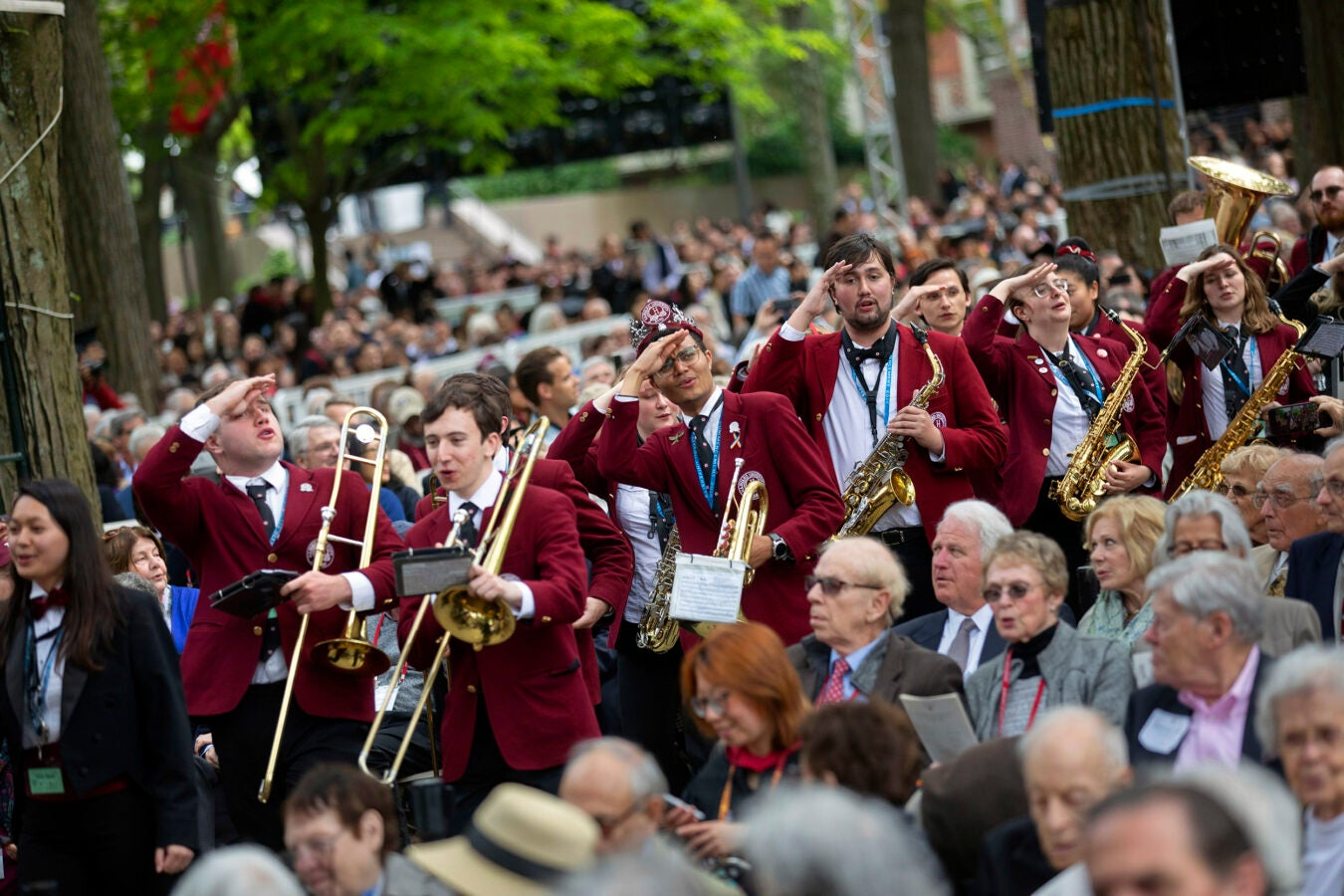 Members of the Harvard Band salute Harvard Alumni Association.