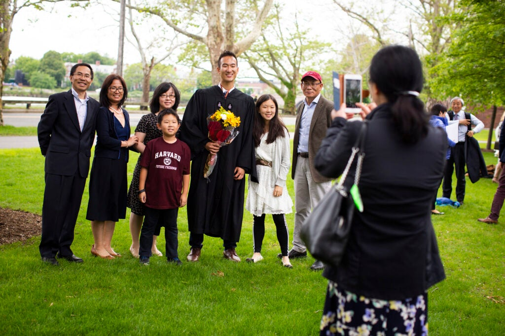 Graduate Michael Liu poses with his family for a photograph.