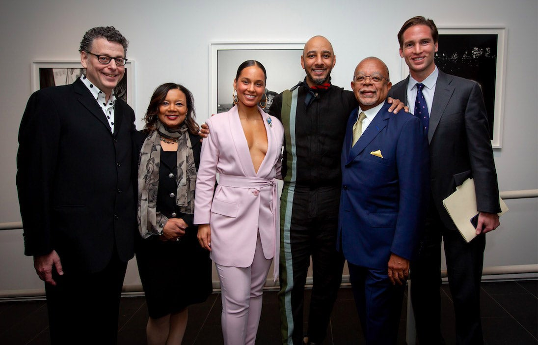 Six people including singer Alicia Keys and her husband Kasseem Dean pose for a group photo