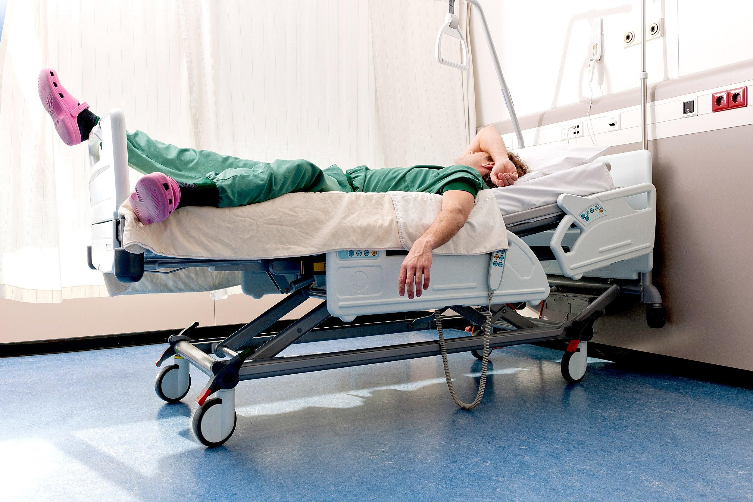 Medical resident sleeping on hospital ward