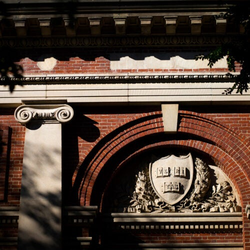 A veritas shield decorates Lowell Lecture Hall at Harvard